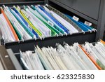files placed on a metal filing... | Shutterstock . vector #623325830