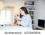 young woman with phone at home. ... | Shutterstock . vector #623345834