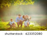 a large family is walking his... | Shutterstock . vector #623352080