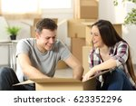 couple moving home packing... | Shutterstock . vector #623352296