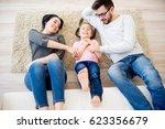 family lying on floor | Shutterstock . vector #623356679