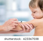doctor vaccinating  baby over... | Shutterstock . vector #623367038