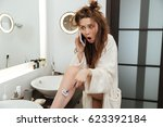 astonished shocked young woman... | Shutterstock . vector #623392184