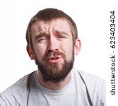 Small photo of Fail again. Unhappy man expressing sorrow on face, grimacing on white isolated background, portrait, copy space