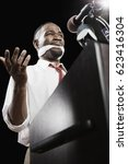 Small photo of African American man at podium with gag in mouth