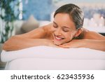 happy woman lying on massage... | Shutterstock . vector #623435936