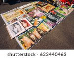 Small photo of FRANKFURT, GERMANY - AUGUST 23, 2015 : Many paintings and puzzles exposed for sale on asphalt in a haggle in Frankfurt.