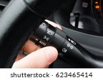 driver hand turning on... | Shutterstock . vector #623465414