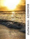 sunrise or sunset on the beach | Shutterstock . vector #623484548