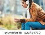 beautiful young woman sitting... | Shutterstock . vector #623484710