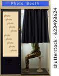 a person covered curtain sits... | Shutterstock . vector #623498624