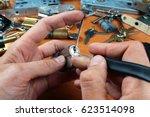 locksmith picks a cylinder lock ... | Shutterstock . vector #623514098