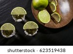 gold tequila shots with lime... | Shutterstock . vector #623519438