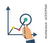 magnifying glass charts.... | Shutterstock .eps vector #623529560