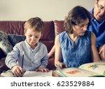 mom teaching her son doing... | Shutterstock . vector #623529884