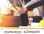 teamwork join hands support... | Shutterstock . vector #623546654