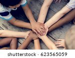 kids are holding hands together | Shutterstock . vector #623565059