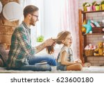 happy loving family. father is... | Shutterstock . vector #623600180
