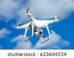 drone flying over sea. white... | Shutterstock . vector #623604524
