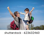 father and son walking on the... | Shutterstock . vector #623632460