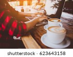 hipster women working in a... | Shutterstock . vector #623643158