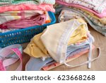 a pile of children's clothes....   Shutterstock . vector #623668268