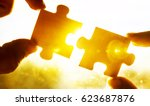 two hands trying to connect... | Shutterstock . vector #623687876