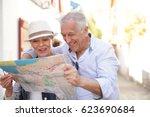 senior couple of tourists... | Shutterstock . vector #623690684