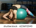 woman doing fitness with a gym... | Shutterstock . vector #623692040