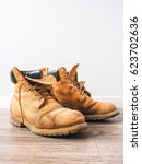 Pair Of Old Yellow Working Boots