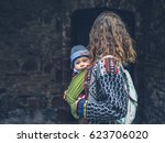 a young mother with her baby in ... | Shutterstock . vector #623706020