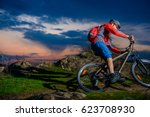 cyclist riding the mountain... | Shutterstock . vector #623708930