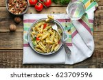plate with delicious pasta on... | Shutterstock . vector #623709596