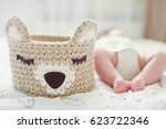 cute baby feet near crochet... | Shutterstock . vector #623722346