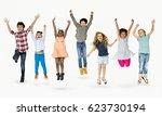 diverse group of kids jumping... | Shutterstock . vector #623730194