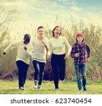 portrait of smiling friends... | Shutterstock . vector #623740454