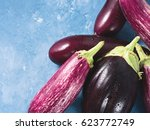 purple eggplants on blue... | Shutterstock . vector #623772749