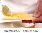 spreading mayonnaise on corn...   Shutterstock . vector #623821436