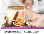scented candle with cinnamon... | Shutterstock . vector #623832224