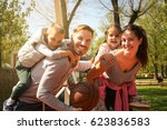 parents playing with their... | Shutterstock . vector #623836583