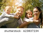 parents playing with their... | Shutterstock . vector #623837234