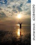 one man standing on a beach ... | Shutterstock . vector #623840090