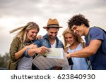 group of tourists searching for ... | Shutterstock . vector #623840930