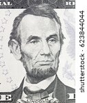 Small photo of Lincoln Abraham portrait on dollar bill closeup