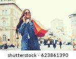 beautiful young woman talking... | Shutterstock . vector #623861390