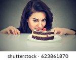 woman craving cake dessert ... | Shutterstock . vector #623861870
