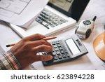 hands of engineer calculating... | Shutterstock . vector #623894228