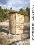 wooden toilet in a village | Shutterstock . vector #623919773