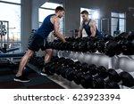 a sportive man in a t shirt... | Shutterstock . vector #623923394
