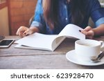 a woman opening and reading a...   Shutterstock . vector #623928470